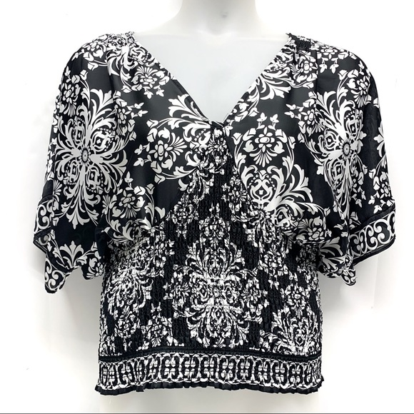 White House Black Market Tops - • WHBM Floral Batwing Smocked Blouse D20